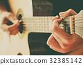 hand play guitar 32385142
