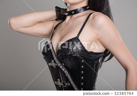 Sexy dominatrix woman wearing black fetish corset 32385764