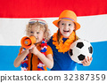 Kids supporting Netherlands football team 32387359