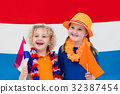 Dutch kids. Children with flag of Netherlands. 32387454