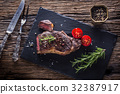 Grill juicy beef steak with salt pepper rosemary 32387917
