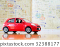 Toy red car on vacation 32388177