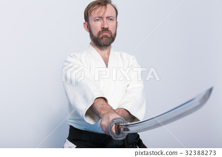 A man with katana on Iaido practice - Stock Photo [32388273