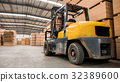 Yellow forklift in a large warehouse. 32389600