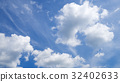 Blue sky and nice white cloud for background. 32402633