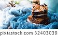 Cream cheese brownies with cookies on blue 32403039