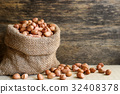Peanuts in hemp sack on wooden background 32408378