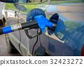 Car at gas station 32423272