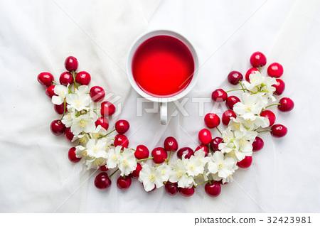 Cherry tea and fruit flatlay 32423981