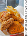 crispy deep fried chicken and french fries 32428902
