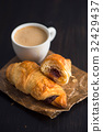 Freshly Baked Croissants with Coffee 32429437