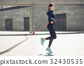 Young woman active exercise workout on street 32430535