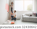Young couple doing apartment repair together 32430642