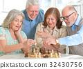 men playing chess 32430756