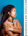 African style woman in ethnic jewelry.Studio shot 32431336