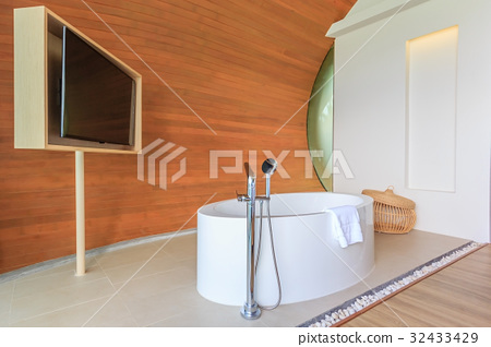 Modern Bathroom interior with a tub standing 32433429