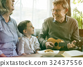 Happiness family playing leisure song with ukulele 32437556