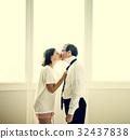 Wife dress and tie businessman husband a necktie 32437838