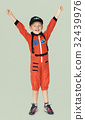 Little boy with astronaut dream job smiling 32439976