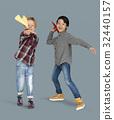 Little Boys Holding Paper Plane Studio Portrait 32440157
