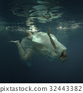 Woman in a dress under the water 32443382