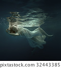 Woman in a dress under the water 32443385