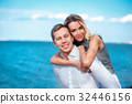 Couple in love  laughing and smiling at beach 32446156