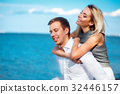 Couple in love  laughing and smiling at beach 32446157