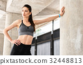 Slim young woman resting after exercising 32448813