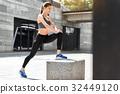 Slim young woman training near stadium 32449120
