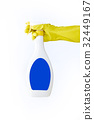 Hand in yellow glove holds spray  bottle of liqui 32449167
