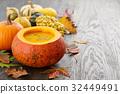 Pumpkin soup with seeds in big decorative pumpkin 32449491