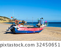Stranded boat in the beach of Salema (Portugal) 32450651