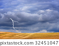 Dark storm clouds and lightning above autumn field 32451047