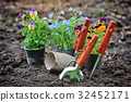 Gardening tools and spring flowers in the garden 32452171