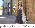Elegant woman travel on street of italian city 32452714