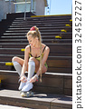 Very Beautiful sexy blonde girl posing on a vintage roller skate 32452727