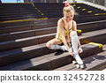 Very Beautiful sexy blonde girl posing on a vintage roller skate 32452728