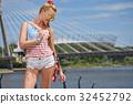 sexy blonde girl posing on a vintage roller skate 32452792