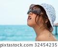 girl enjoys vacation on the sea coast 32454235