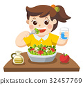 A Little girl happy to eat salad. Love vegetables. 32457769