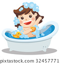 A baby girl taking a bath in bathtub with her toy 32457771