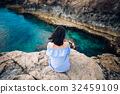 Young woman enjoying beautiful sea view on Greco cape in Cyprus 32459109