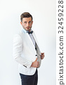 Portrait of handsome stylish man in white elegant suit 32459228