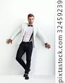 Full length portrait of handsome man in white elegant suit posin 32459239