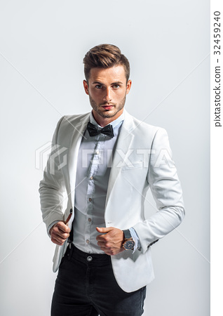 Portrait of handsome stylish man in white elegant suit 32459240