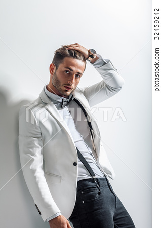 Portrait of handsome stylish man leaning at wall 32459242