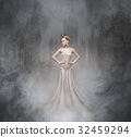 Young woman in an evening dress and jewels 32459294