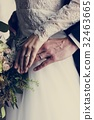 Bride and Groom Showing Their Engagement Wedding Rings on Hands 32463665