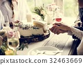 Bride and groom cutting wedding cake together 32463669
